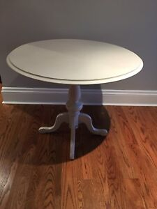 Round accent/dining table, solid pine wood, painted light grey.