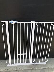 Extendable dog gate with small and large door