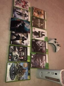 Xbox 360 and 1 controller with 11 games(shown)