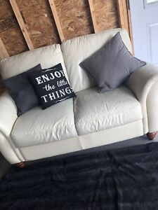 Off white leather couch , located in Grand Valley ON.