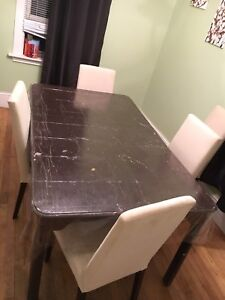 Dinning table and 5 chairs for sale.