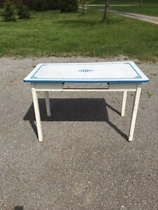 Antique table with enamel surface