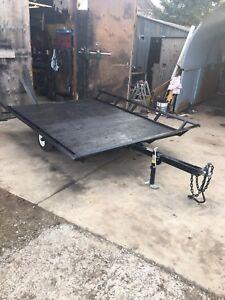 Tilt deck quad or sled trailer
