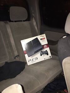 PS3 in box 2 wireless controllers and all wires