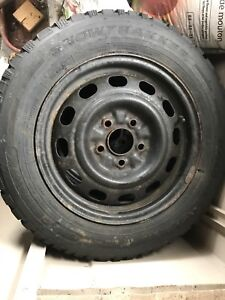 4 pacemark snowtracker tires and rims