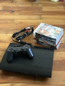 Barely used, SuperSlim, PlayStation 3 console w/ games *500GB