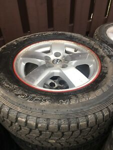 225 75R16 Dunlop Winter Tires on Dodge Caravan wheels