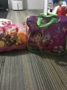 Brand new Dora blocks and brand new bag of kitchen play food