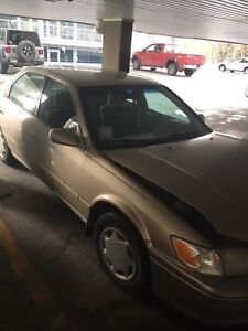 2000 Toyota Camry for parts or fix - damaged but still drives