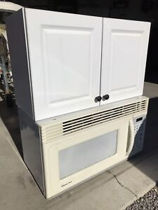 Microwave cabinet (over the stove)  30 W x 35 H x 15 deep