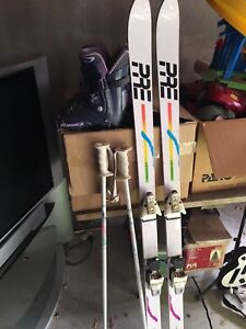 Woman's skis with poles and boots