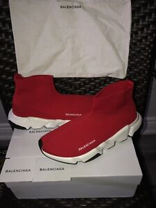 Red balenciaga speed trainers.