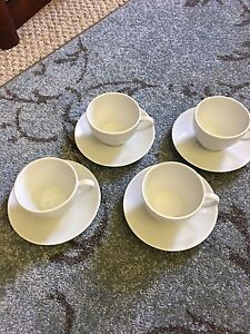 4 white ceramic tea cups and saucers