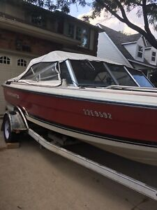 1987 Starcraft 20' boat and trailer with motor