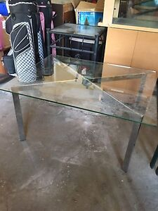 Glass coffee table with metal legs