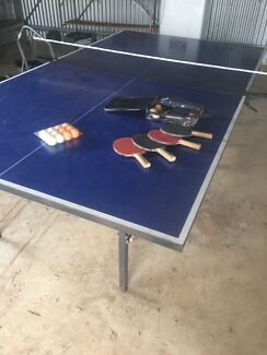 Table tennis table with racquets and balls