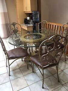 Round glass dinette set with leather chairs for sale