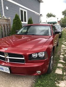 2009 Dark red Dodge Charger sxt  with 105 000kms