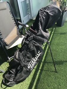 Titleist Golf Bag including three drivers and putter
