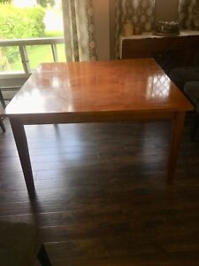 Solid wood dining table with butterfly leaf for sale!