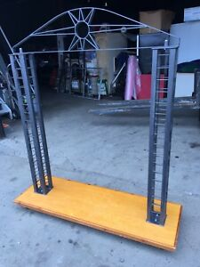 New Clothing Display Rack Metal with Wooden Rolling Base
