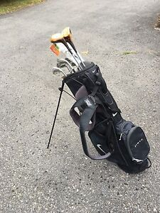 Nike Sport Lite carry golf bag - assorted Wilson golf clubs.