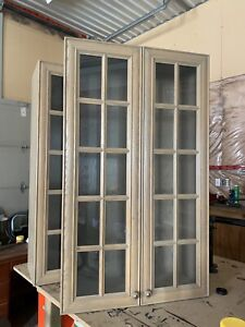 2 Glass front upper cabinets with glass shelving