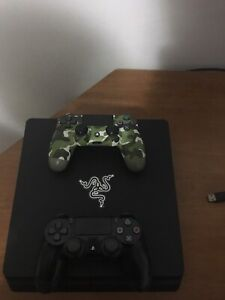 Ps4 Slim 2 1TB 2 controllers (1 has scufs) 10/10 condition