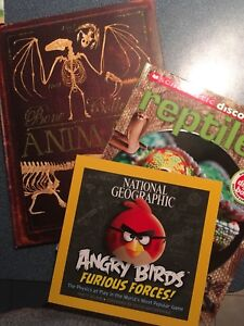 Books, Reptiles, Animal bones and angry birds, with insect pod