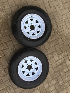 """Trailer rims and tires. 14"""". Two. Less than 500 km's."""