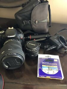 Canon T3i with Sigma 18-200 and Canon 50mm lens