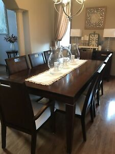 Wood dining room suite with 8 chairs