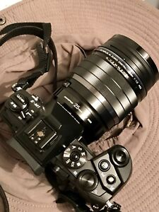 Like New Olympus em-1 + two chargers + three batteries