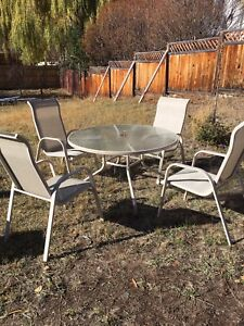 Glass patio table & 4 chairs
