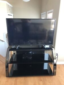 "Toshiba 50"" LED TV w/ Sonax TV stand"