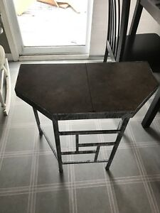 Metal table with tiles