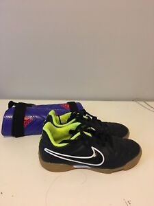 Soccer shoes and purple shin pads