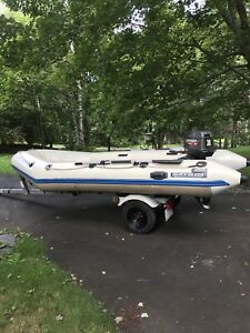 16 ft quick silver zodiac in perfect condition, 30hp Johnson