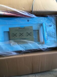 GE Over -the-range microwave oven brand new