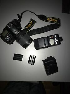 Nikon D7000 SLR and accessories .