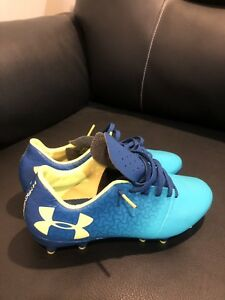 Under Armour Cleats & Shin Pads (BRAND NEW)