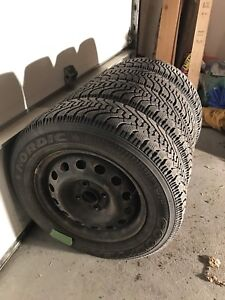 4 Goodyear Nordic 185/70/R14 winter tires with 4x100 rims