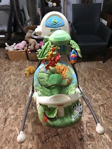 Fisher price rainforest baby swing.