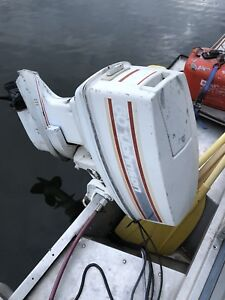 60 hp Johnson outboard with controls and 2 gas cans