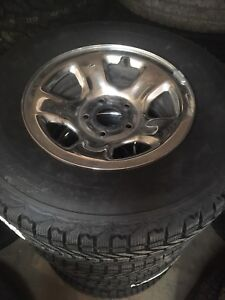 Dodge Ram 1500 rims with new winters.