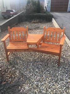 Cedar two seat bench with table.