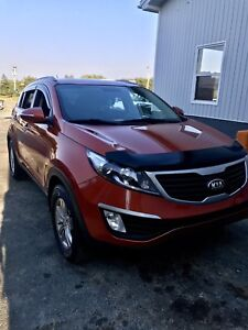 2013 Kia Sportage trade for car of equal value.