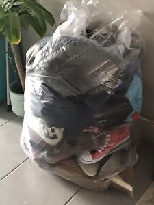 HUGE bag full of shoes, boots, kicks and flip flops and jackets