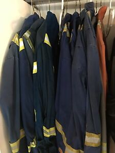 Assorted used coveralls