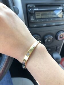 14K Cartier Style Bangle & 18K Ring